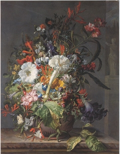 Flowers in a stoneware vase on a marble ledge