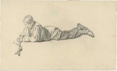 Liggende jongen met een stok