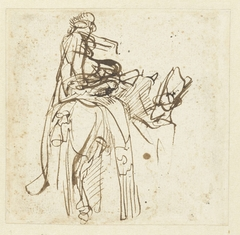 Man helpt een ruiter te paard