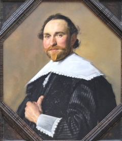 Portrait of a man in 8 sided frame