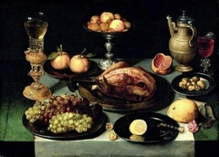 Still Life with Roast Chicken on a Laid Table with Grapes, a Bekerschroef, Tazza and Wine Flask
