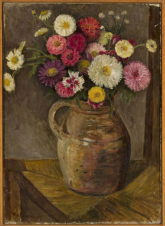 Asters and zinnias in a clay jug