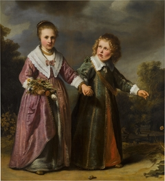 Double portrait of a boy and girl, full-length, in a landscape