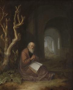 Een biddende kluizenaar in een ruïne