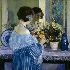 Girl in Blue Arranging Flowers