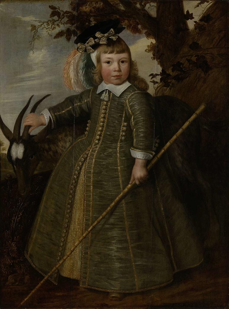 Portrait of a boy with a billygoat