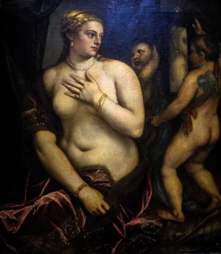 Seated Venus with her Mirror held by Cupid