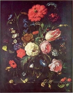 Still life of flowers in a glass vase upon a stone ledge