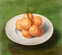 Still life with oranges on a plate
