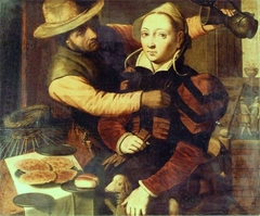 A fisherman making merry with a lady at a table