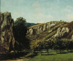 Mountainous landscape with fruit trees in Ornans