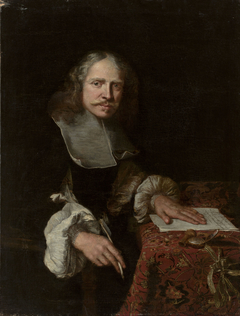 Portrait of a man writing a letter.