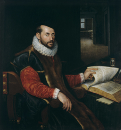 Portrait of a Sitting Man Leafing Through a Book