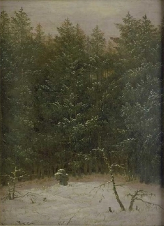 Snowy forest with stone cross