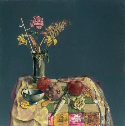 The table with flowers and fruits