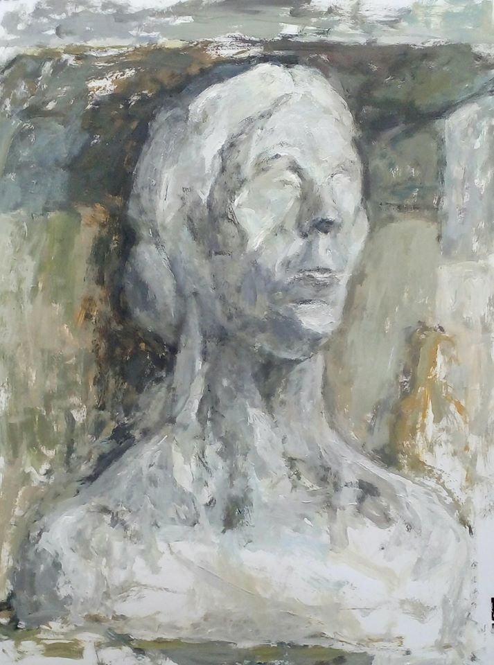 Woman statue with yellow bottle
