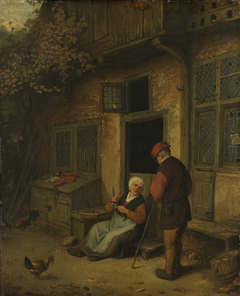A woman gutting herring in front of her house