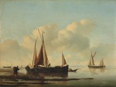 Calm sea with fishing-boats near the coast