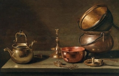Copper kettles and other objects on a tabletop