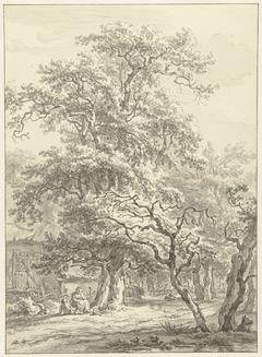 Moeder en kind zittend onder bomen