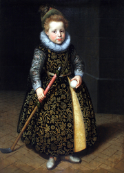 Portrait of a four-year old boy with a club and ball