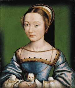 Portrait of a lady holding a puppy