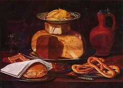 Still life with cheese, bread and pretzels