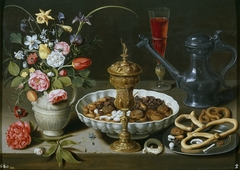 Still life with flowers, goblet and dainties