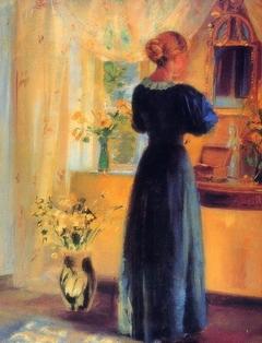 Ung pige foran spejl