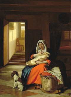 Woman nursing by a cradle with a dog at her feet