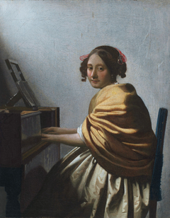 A Young Woman Seated at the Virginals