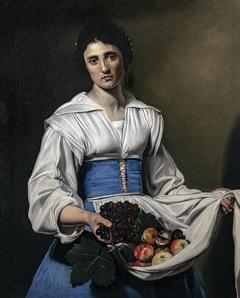 Paysanne portant des fruits