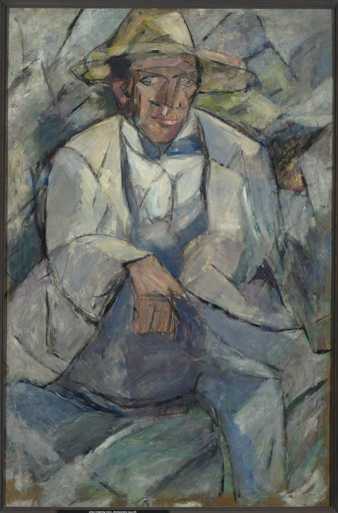 Portrait of a man in a white hat