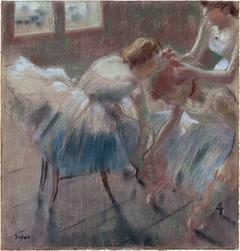 Three Dancers Preparing for Class