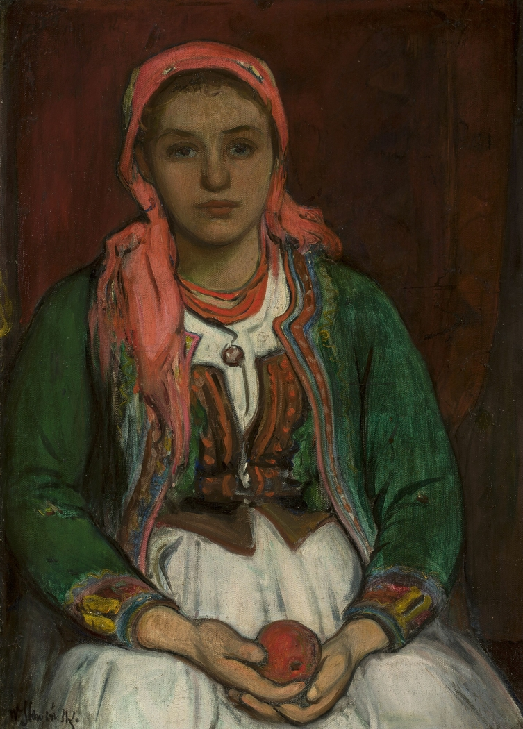 Young woman from the Highlands with an apple