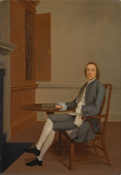 An Unknown Man Seated at a Table