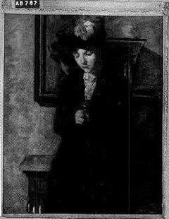 Een vrouw bij de spiegel
