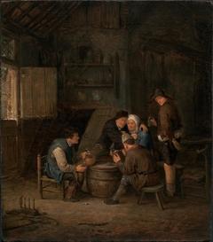 Peasants Gathered Round a Barrel