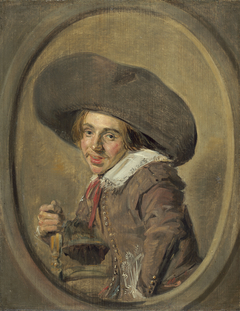 Portrait of a seated young man with a broad brim hat