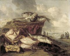 Stilleven met vis en twee manden op het strand