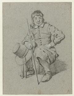 Zittende jongen met stok en hoed