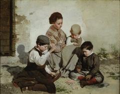 Chicos jugando a las cartas