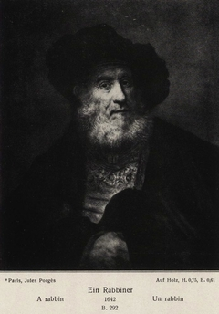 Old man with beard and beret and hand in his cloak