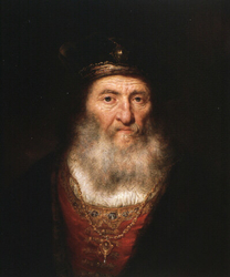 Old man with beard and beret wearing a medaillon