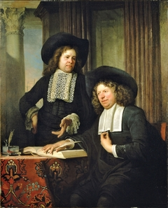 Portrait of two men by a table with books and writing tools