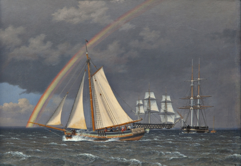 Rainbow at sea with some cruising ships