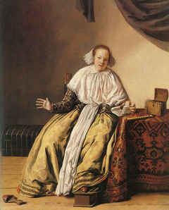 A young woman seated by a table
