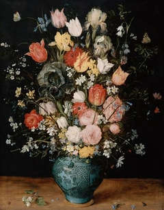 Chinese porcelain vase of flowers on a tabletop