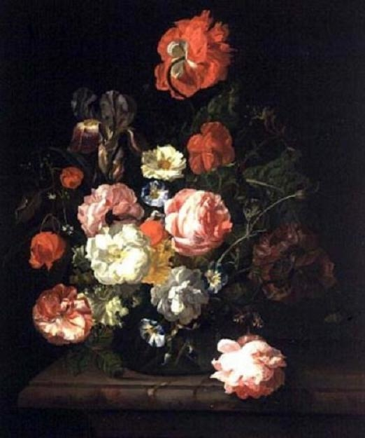 Flowers in a glass vase on a marble slab