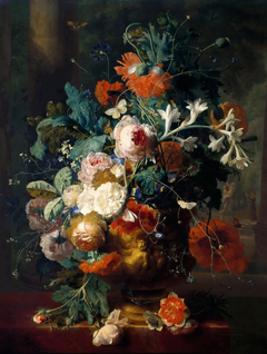 Flowers in a vase on a pedestal